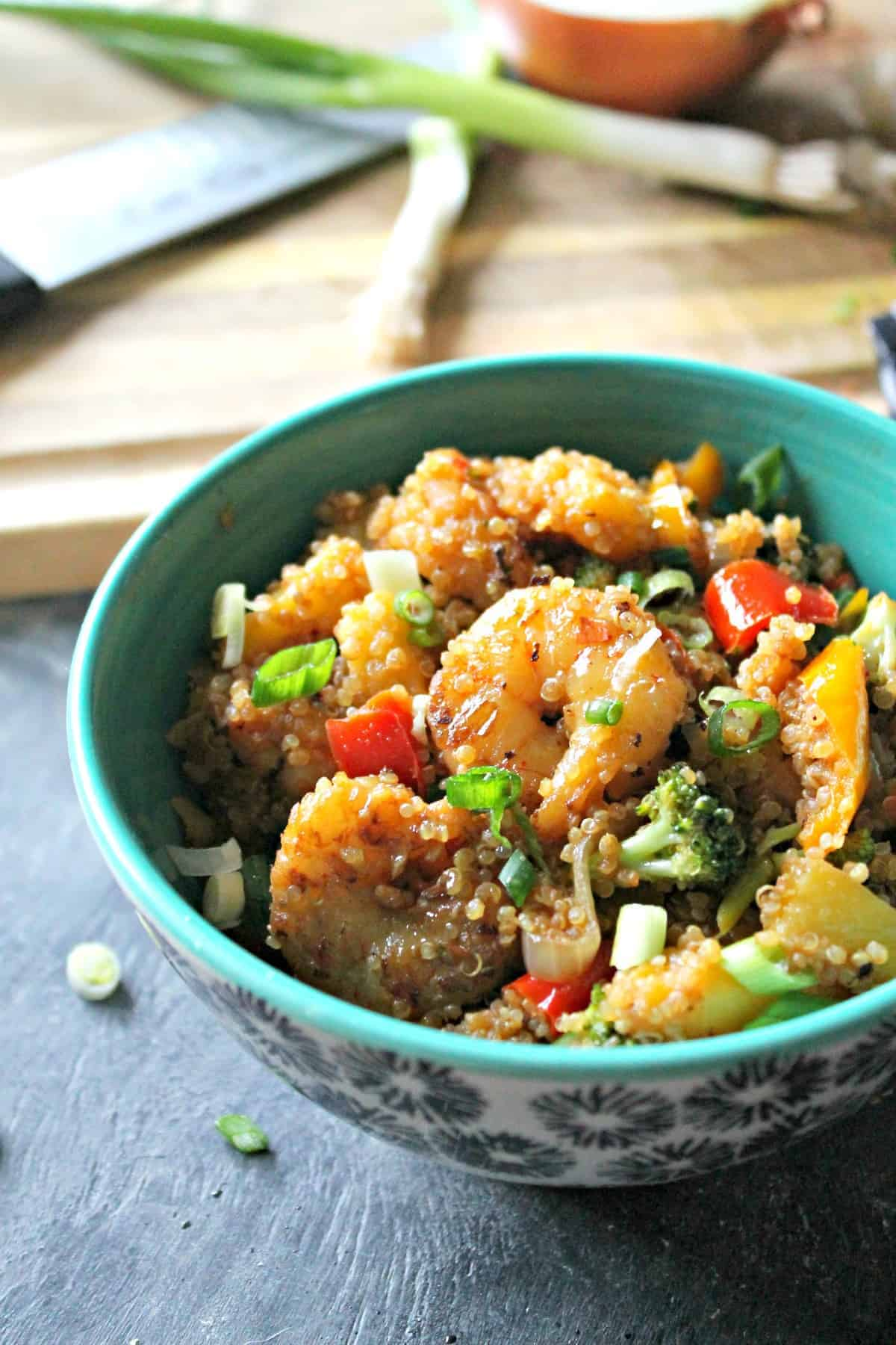 Sweet Pineapple Shrimp and Quinoa Stir Fry bowls with sweet peppers