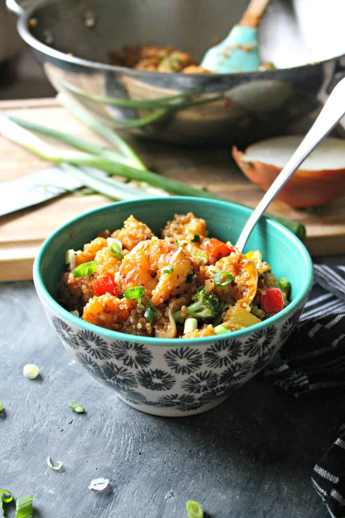 Pineapple shrimp on a bed of quinoa and sweet bell peppers