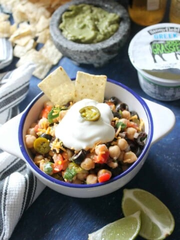 """""""Nacho"""" Chickpea Salad. Packed with protein and fiber, and loaded with classic nacho toppings, this salad is an ideal snack for that snacky feeling that tends to creep up while game-watching."""