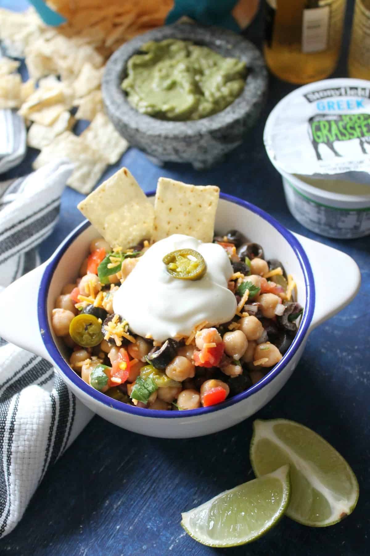 """Nacho"" Chickpea Salad. Packed with protein and fiber, and loaded with classic nacho toppings, this salad is an ideal snack for that snacky feeling that tends to creep up while game-watching."