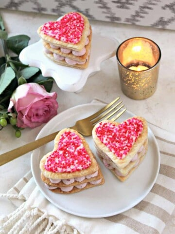 Easy Cherry Mousse Napoleons! This gorgeous dessert, consisting of layers of store bought puff pastry and a simple creamy cherry filling, comes together quickly. A fancy fake-out!