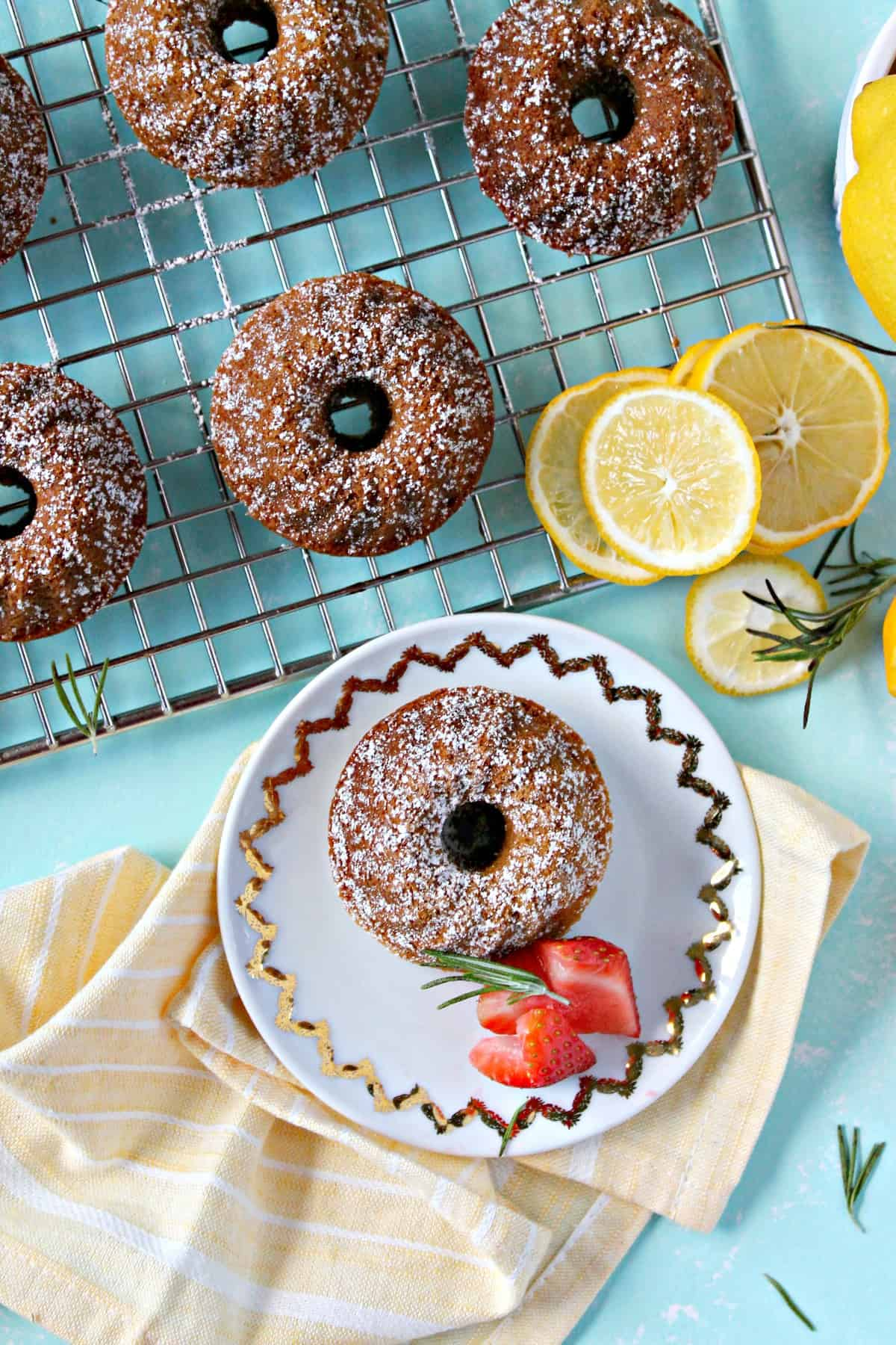 A dusting of powdered sugar gives these mini lemon rosemary bundt cakes an extra hint of sweetness