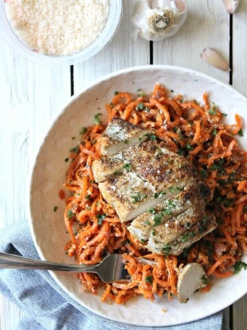 Garlic & Parmesan Carrot Spiral Bowls! Quick and easy spiralized carrots get a flavorful pop from garlic and Parmesan. Serve topped with your favorite protein for an easy, healthful weeknight meal!