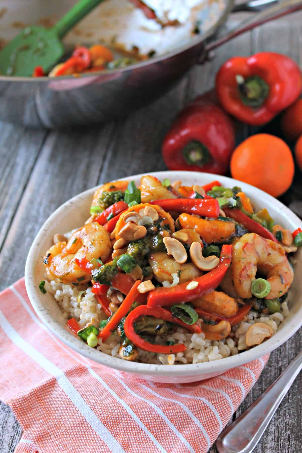This easy shrimp and vegetable stir fry is bursting with colorful flavor. Florida tangerines and sweet peppers add pops of zest