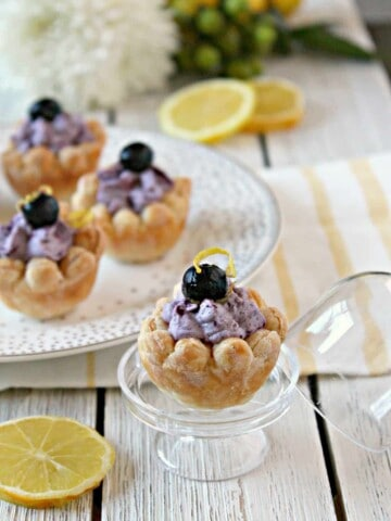 Blueberry Lemon Puff Pastry Blossoms! A sweet spring treat, these pretty little bites are made with store bought puff pastry and filled with a heavenly blueberry-lemon cream. A great addition to brunches, showers and tea parties.