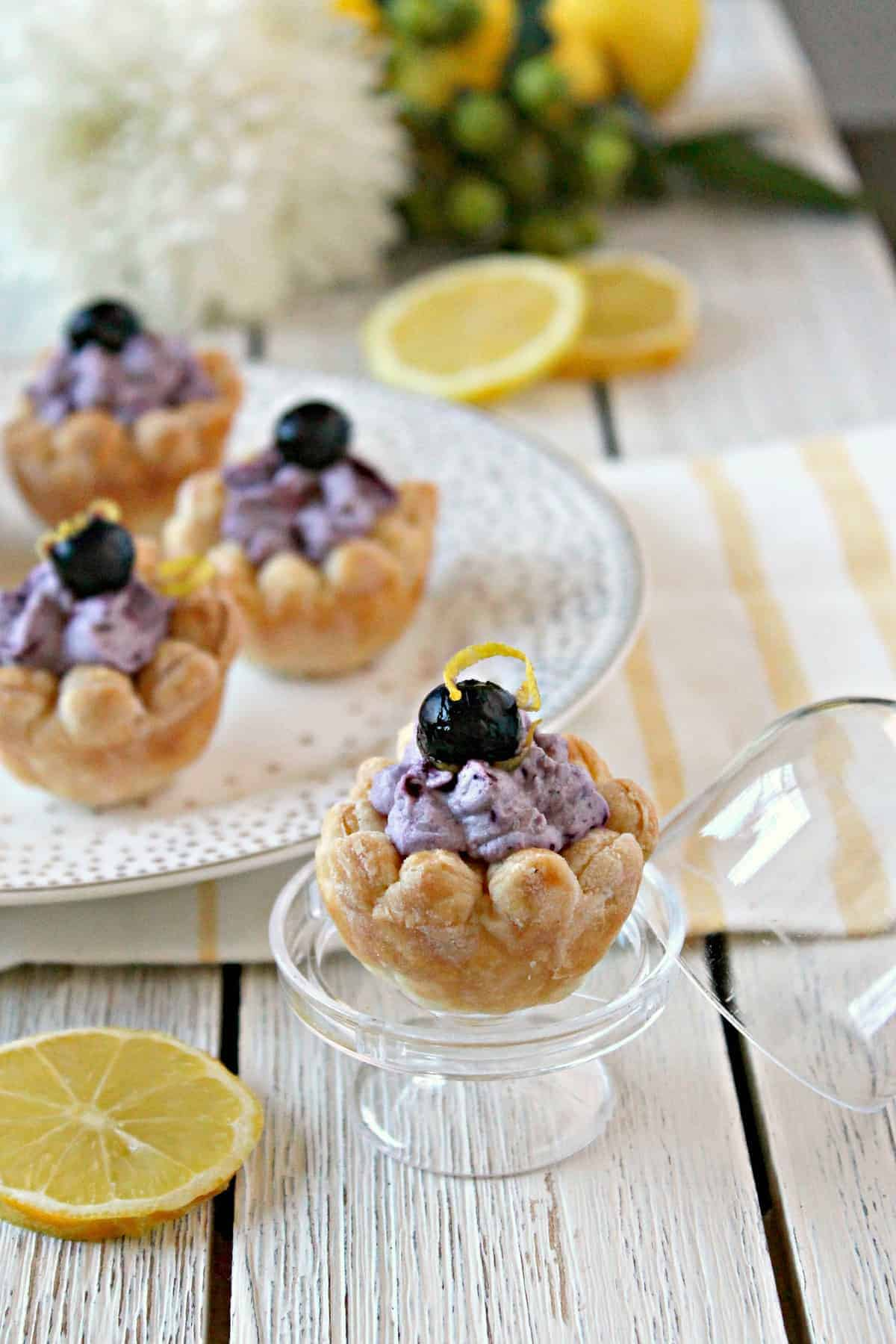 These adorably and delicate lemon and blueberry puff pastry blossoms are a sweet and simple treat