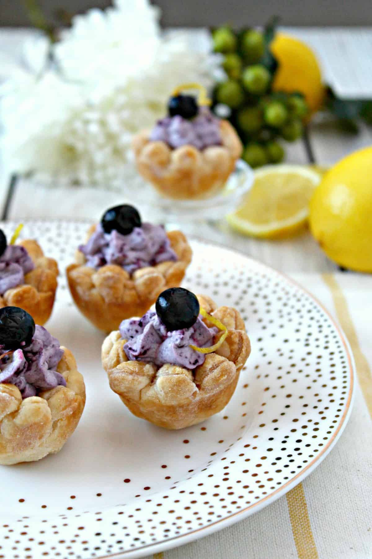 Light and creamy blueberry whipped filling delicately piped into a flaky puffed pastry blossom