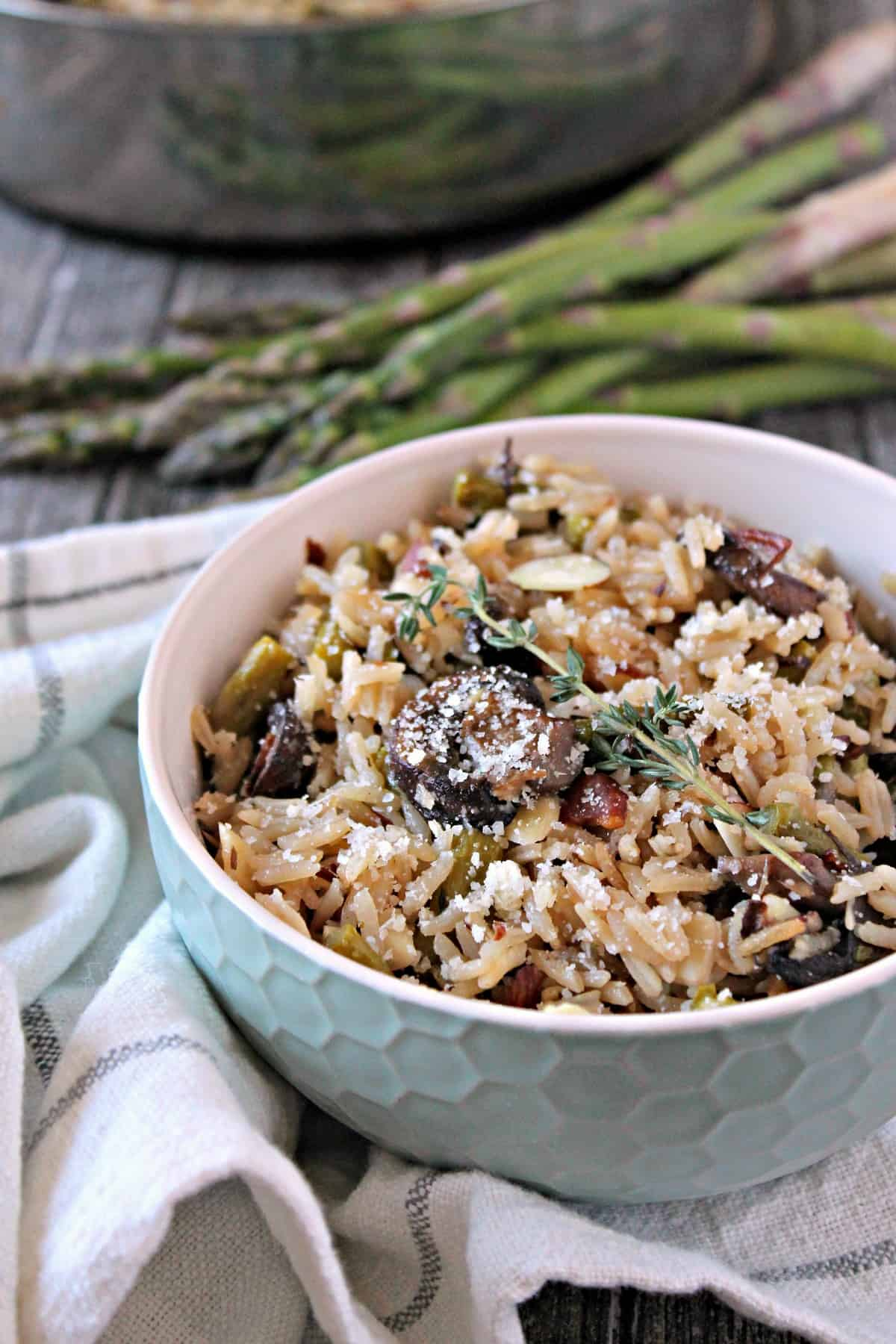 Baked Parmesan, Asparagus & Mushroom Rice Pilaf. This savory side dish starts on the stove top, then bakes to perfection in the oven, resulting in perfect rice every time. A great complement to spring meals!