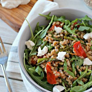 Springtime Farro Salad with Burrata! This simple spring salad is bursting with fresh flavors from seasonal vegetables to a zesty vinaigrette. Creamy burrata elevates it to a salad worth serving to company.