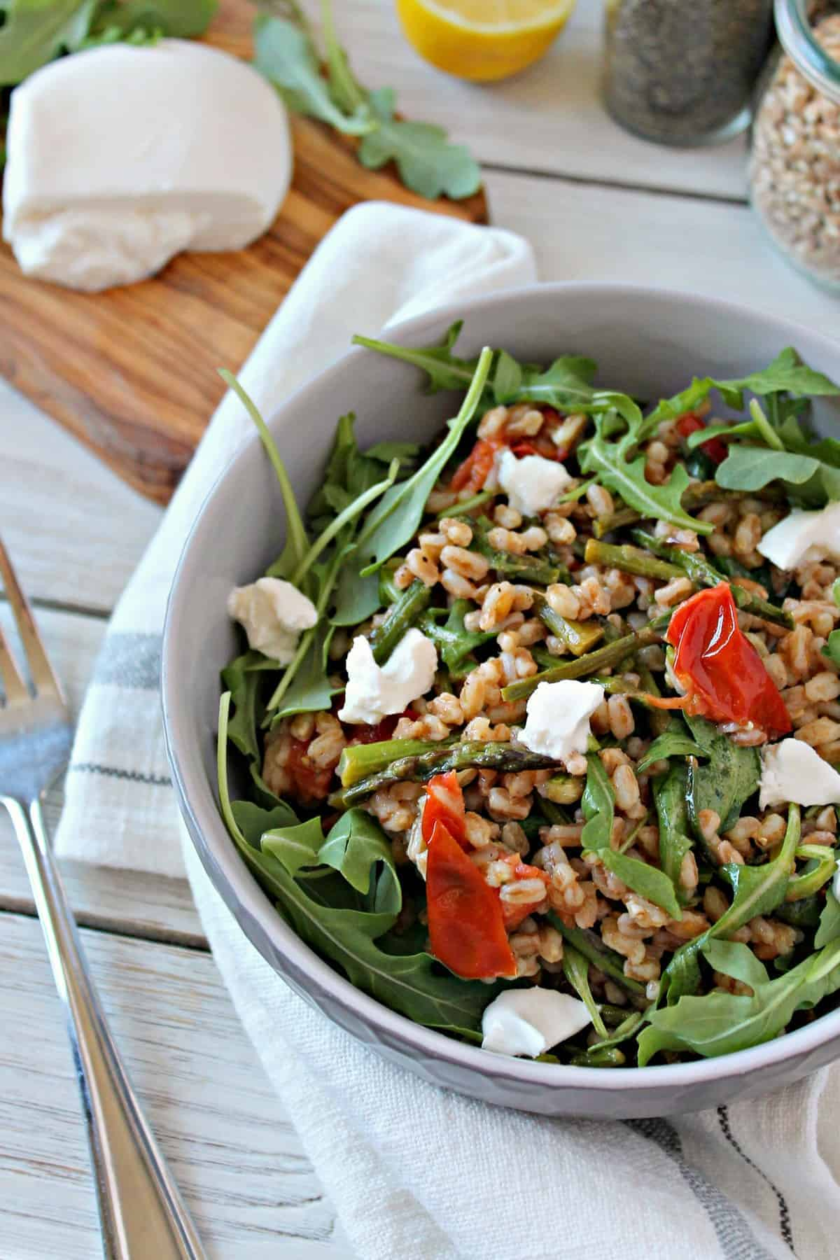This fresh Springtime Farro Salad is topped with creamy burratta cheese
