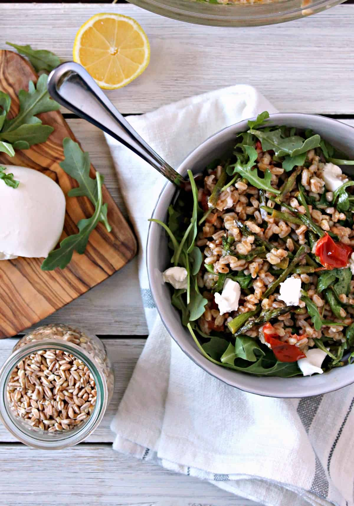 This light and fresh Springtime Farro Salad is topped with creamy burrata cheese and sun dried tomatoes