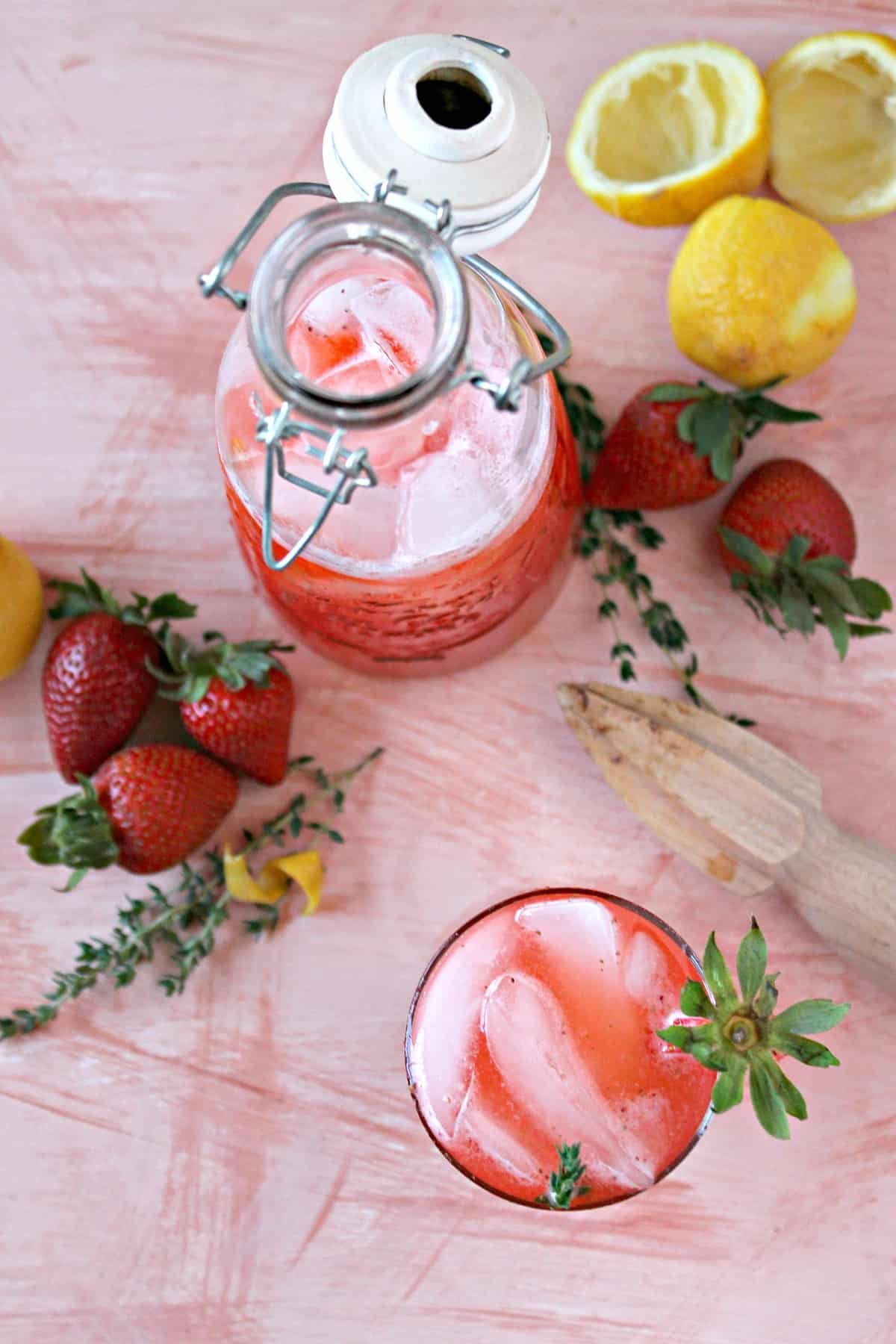 Strawberry-Thyme Lemonade! Sweet strawberries, take the pucker out of fresh-squeezed lemon juice in this delicious version of classic lemonade. The addition of homemade thyme-infused simple syrup adds a delightfully herbaceous note. It's spring in a glass!