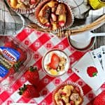 Strawberry Vanilla Bean Baked French Toast Cups! Whether you're having a picnic or hosting a brunch, this bite-sized, berry-filled version of French toast will bring smiles to everyone's face!