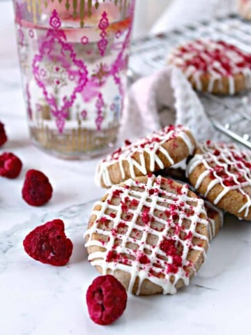Raspberry Shortbread with White Chocolate Drizzle! Buttery, melt-in-your-mouth cookies with a hint of raspberry flavor, these tender cookies make a wonderful tea time treat.