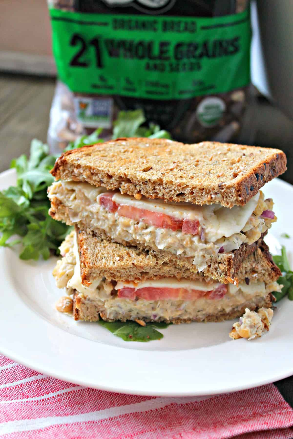 Chickpea Tuna Melt Sandwich! This vegetarian version of the classic diner sandwich makes a fantastic, protein-filled lunch. Made with mashed chickpeas and topped with gooey cheese, no one will miss the tuna in this clever, satisfying knock-off.