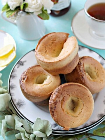 Lemon Vanilla Bean Popovers! This sweet version of a British classic {Yorkshire Pudding} is perfect for serving up at brunches and parties. The batter comes together quickly in the blender, then poured into a standard muffin tin where they bake up into light, hollow nibbles!