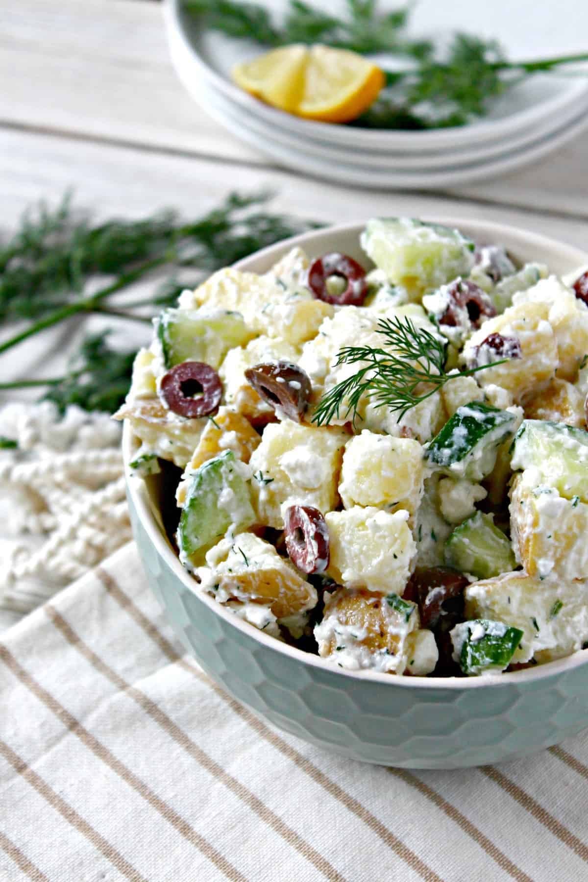 Tzatziki Potato Salad with Kalamata Olives! A fresh, lighter take on a summer favorite, this potato salad features flavors found in tzatziki, a Mediterranean yogurt-based sauce that's often served as a dip or in accompaniment to grilled meats. Salty Kalamata olives and feta cheese give the classic summertime side dish a new spin that will keep everyone coming back for more.