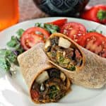 Portobello Fajita Wraps! Taco-spiced portobello mushrooms, onions and peppers make this vegetarian wrap both flavorful & filling. It's a perfectly portable lunch that's sure to hit the spot!