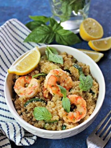 Lemon Basil Shrimp & Quinoa! This fresh and flavorful dish comes together in no time at all, making it ideal for a healthful weekday dinner or packed lunch. Make quinoa early in the week or simply defrost pre-made frozen quinoato shave off prep time during busy evenings, and this will become a go-to staple for busy evenings.
