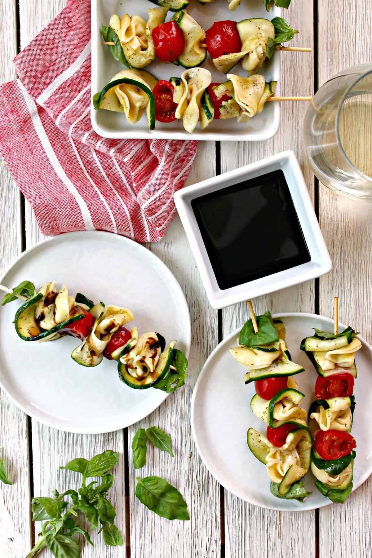 Zucchini & Tortellini Skewers are made with fresh cooked tortellini, zucchini, basil, and fresh cherry tomatoes and served with a balsamic dip