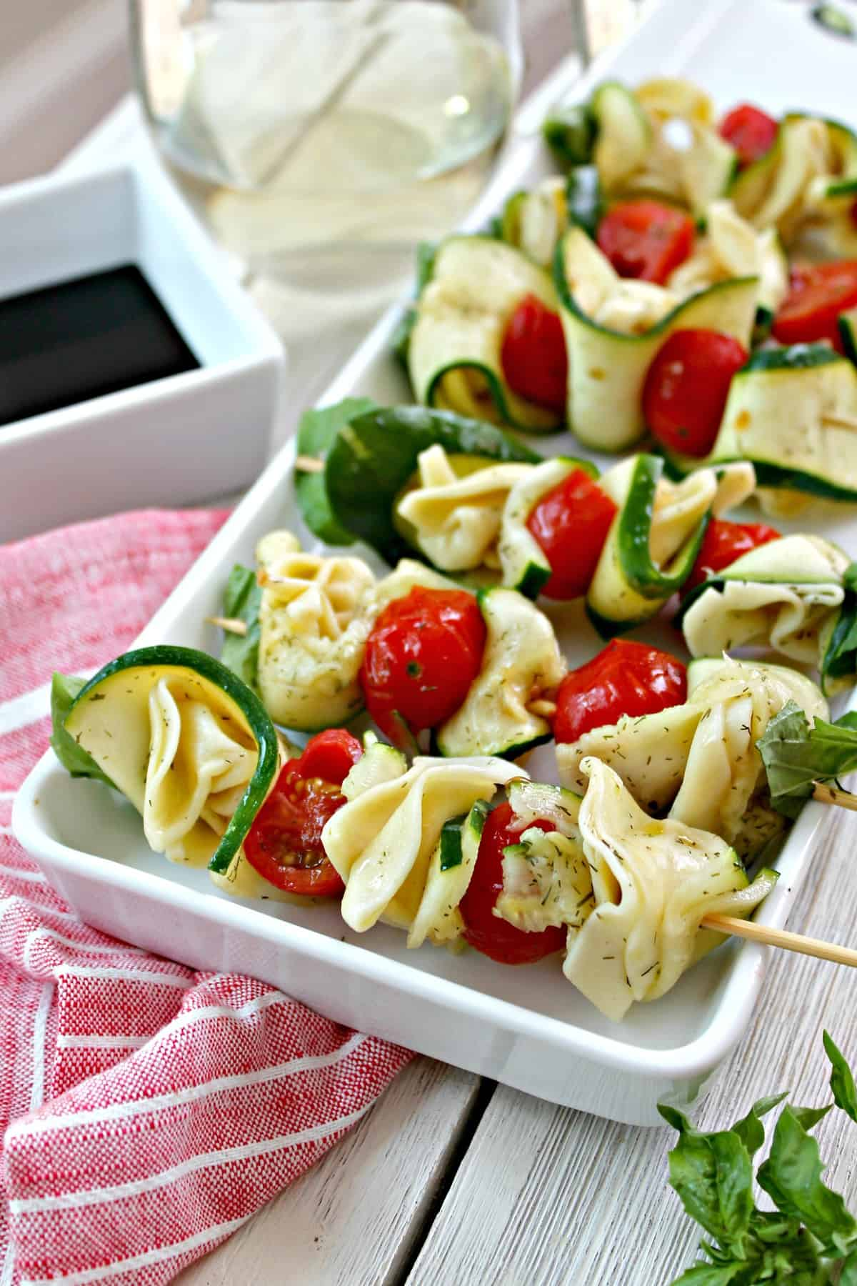 Easily make these Zucchini & Tortellini Skewers ahead of time and serve day-of for a quick and delicious party appetizer