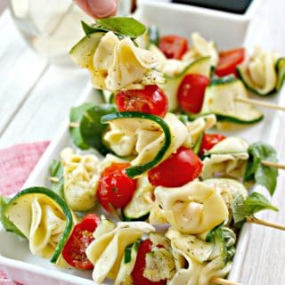 Marinated Zucchini & Tortellini Skewers! Looking for an easy appetizer to serve up at a party or bring along to a gathering? These incredibly simple skewers are just the thing! They're crowd-pleasing, easy to make and appealing to the eye, too!