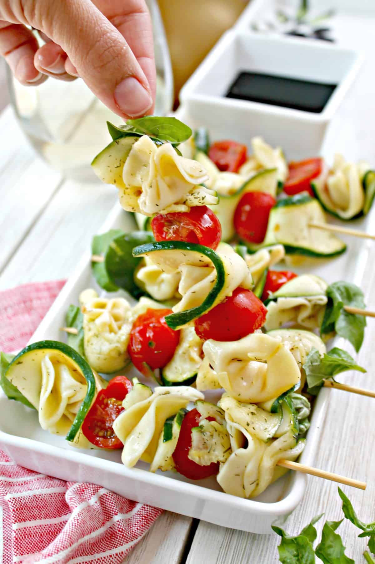 These easy Zucchini & Tortellini Skewers are a perfect appetizer to serve at a party.