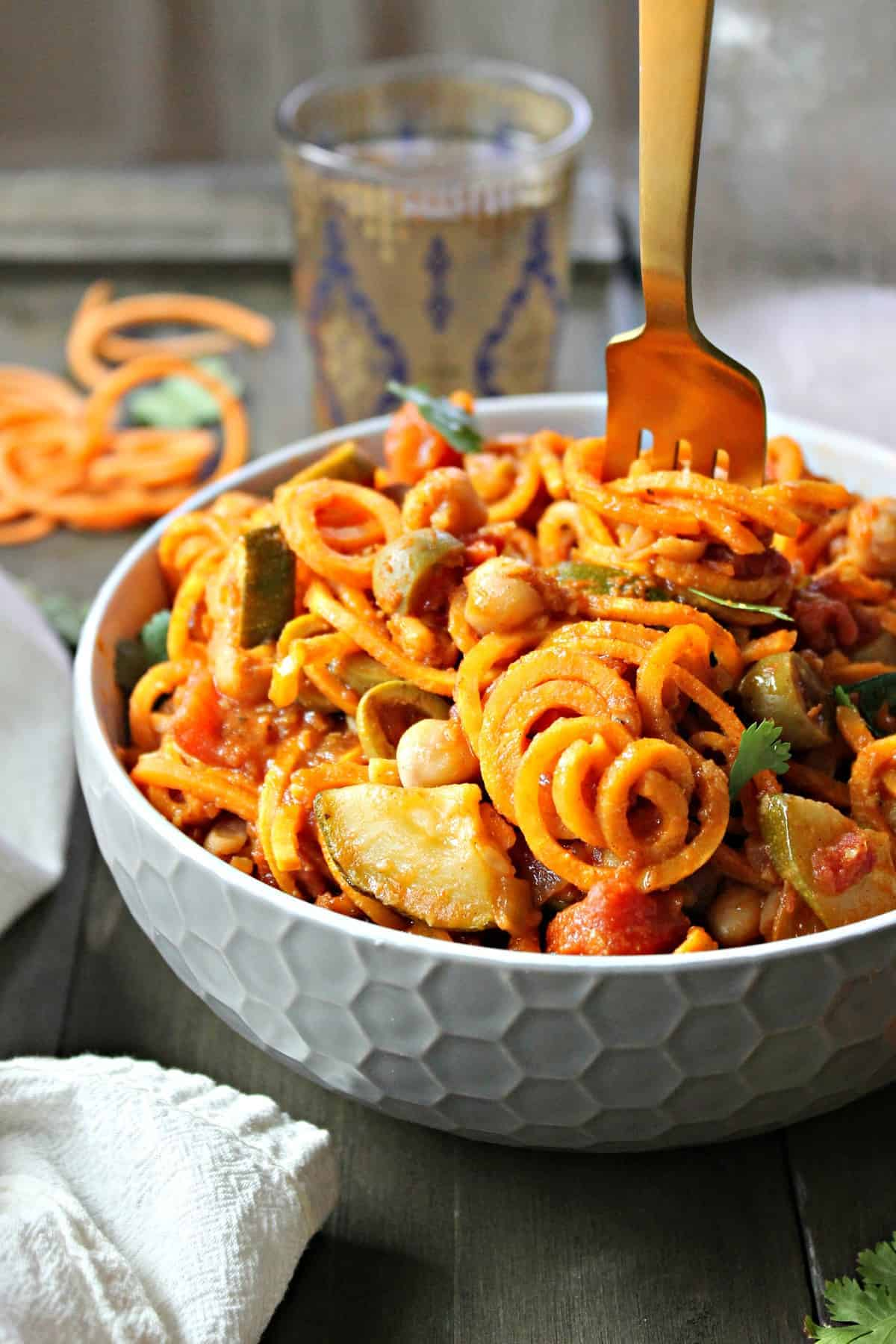 A healthy sweet potato noodle skillet with fragrant Moroccan spices and vegetables