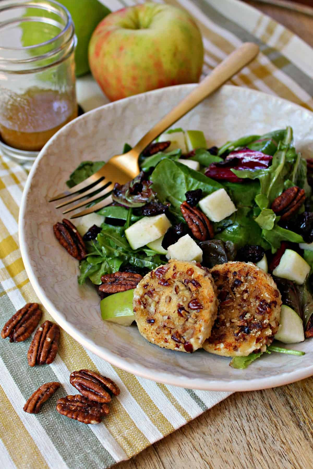 This fresh and crisp autumn harvest salad has apples, cranberries, and warm goat cheese in every bite