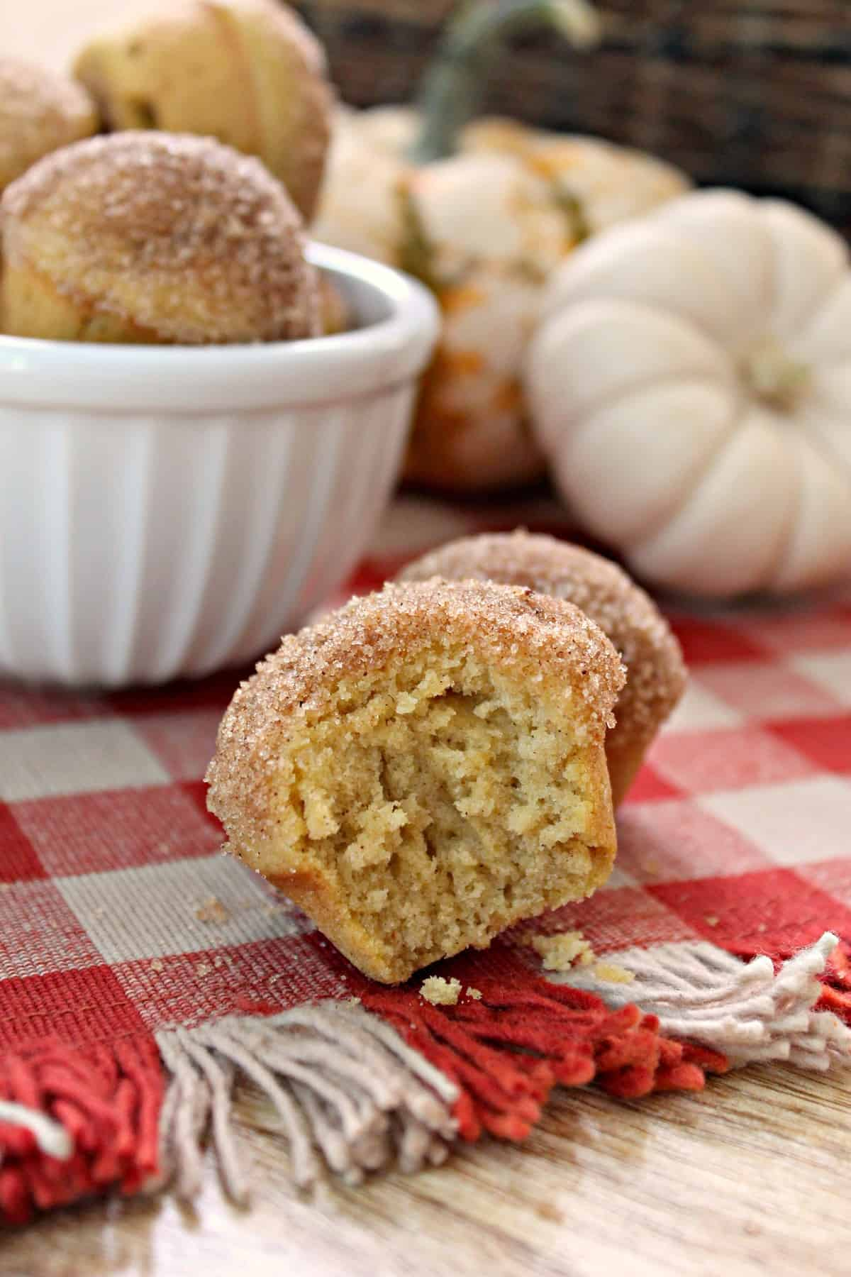 Mini Pumpkin Spice Donut Muffins! These petite pumpkin spice muffins imitate a breakfast favorite with a sugar and spice-encrusted dome. All of the flavors of fall rolled up into a tasty breakfast or brunch treat!