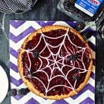 """Spider Web"" Blackberry Dessert Pizza! Looking for a sweet, spooky snack with a little less sugar? This creepy-crawly dessert is honey-sweetened & topped with fresh blackberries for a treat without the sugar rush!"
