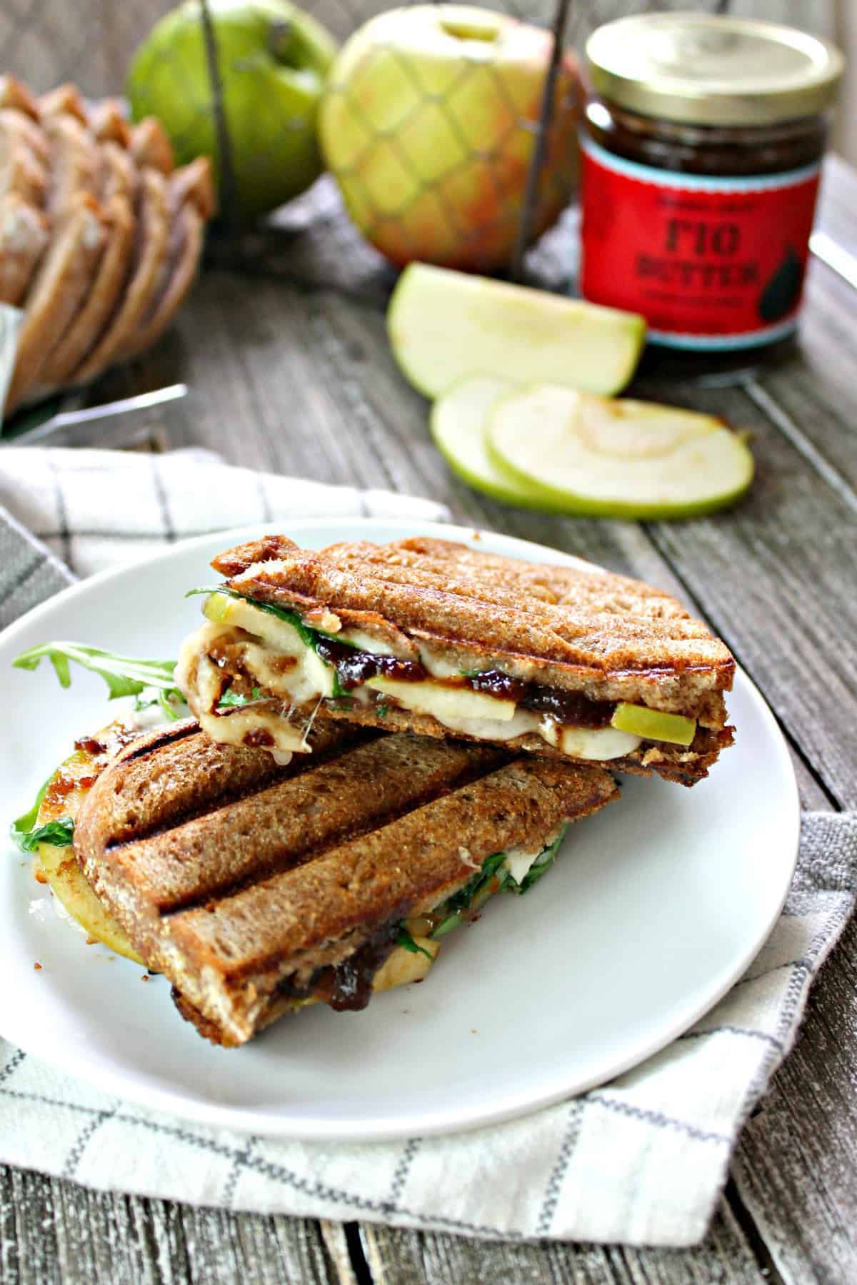 Manchego, Fig & Apple Panini! Even quick and easy lunches can be seasonal and flavorful; the proof is in this panini! Crusty bread is slathered with fig preserves, then topped with manchego cheese & tart apple slices and grilled to melty perfection!