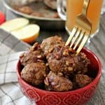 Cider Glazed Turkey Apple Meatballs! Shredded apple keeps these easy meatballs juicy & flavorful. Tossed in a sweet cider glaze, they make a great fall party appetizer or accompaniment to rice or quinoa for a quick dinner.