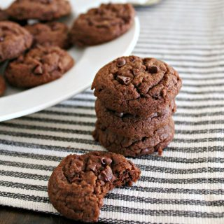Chocolate Chocolate Chip Cookies! These cookies are a deep, chocolaty, mini-chip-studded version of my favorite chewy chocolate chip cookie recipe! Made with melted butter and requiring no chilling time, they're an easy recipe to whip up for last minute gatherings or any celebration!