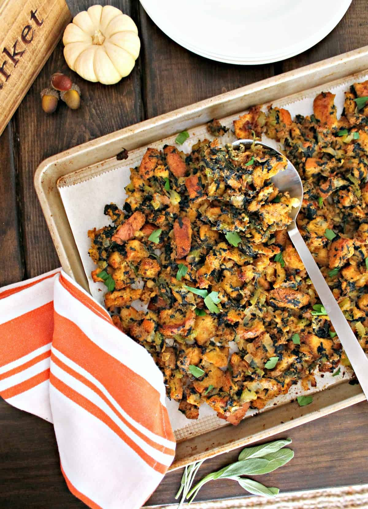 Vegetarian Sheet Pan Stuffing! If you've got a family who fights over the crispy parts of the Thanksgiving stuffing, this recipe will ensure everyone gets what they want! Baking on a sheet pan creates extra texture on this wonderful {vegetarian!} twist on a beloved holiday recipe.