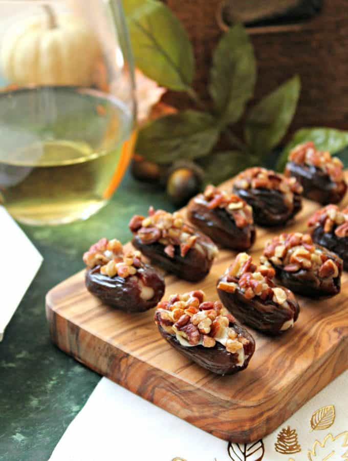 Honey-Cinnamon Cream Cheese Stuffed Dates! Sweet, sticky dates are stuffed full of honey-sweetened, cinnamon-spiced cream cheese, then rolled in crunchy roasted pecans. A perfect snack or appetizer to prepare last minute holiday entertaining!
