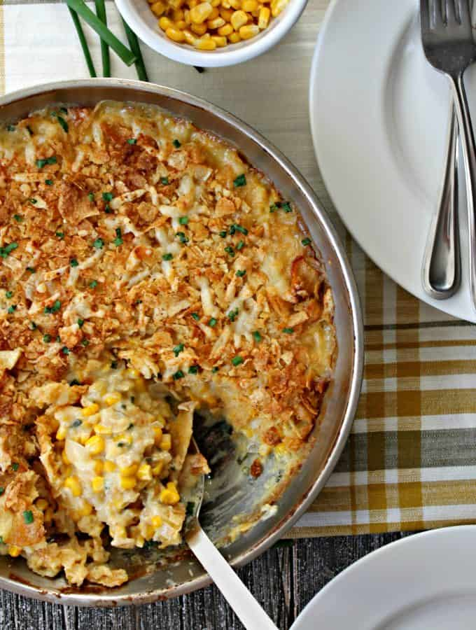 Sour Cream & Chive Corn Casserole! This easy corn casserole recipe gets extra points for easy cleanup since it's made in one skillet! Rich sour cream and sharp cheddar cheese elevate corn to an indulgent level, while crushed potato chips add texture and crunch! A great side dish for the holidays and easy enough to make on a weekday.