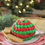 "Mint Cookies & Cream Dessert Cheese Ball! Crushed creme-filled chocolate cookies stud a sweet and creamy cheesecake ""ornament"". A hint of mint gives it a holiday twist! This last minute holiday dessert couldn't get any easier or cuter! Serve with fruit or cookies for a festive treat."