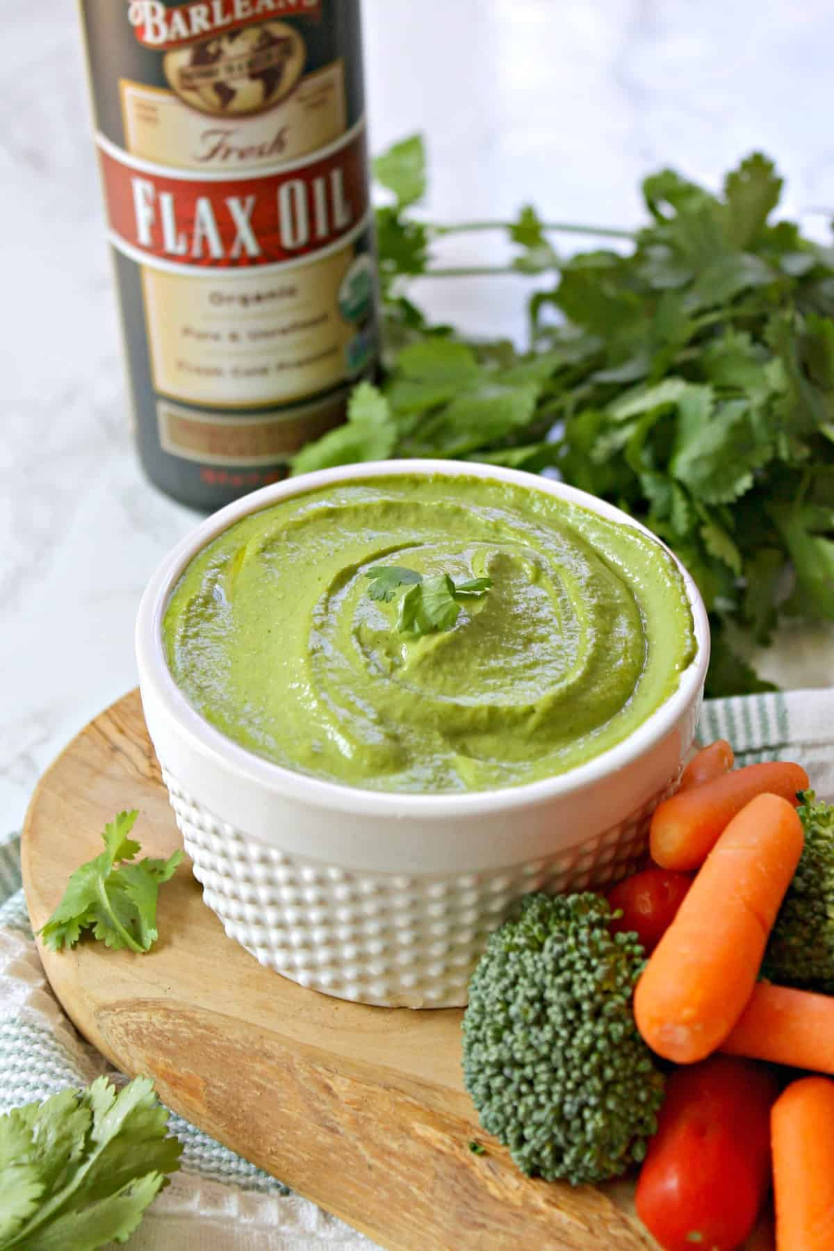 Green Tahini Spread! This delicious spread is made with tahini -- a ground sesame seed paste -- and is so versatile! Use it as a dip, spread or dressing for an unexpected creamy richness without any dairy. The addition of flax oil lends added benefits to this nutritious spread!