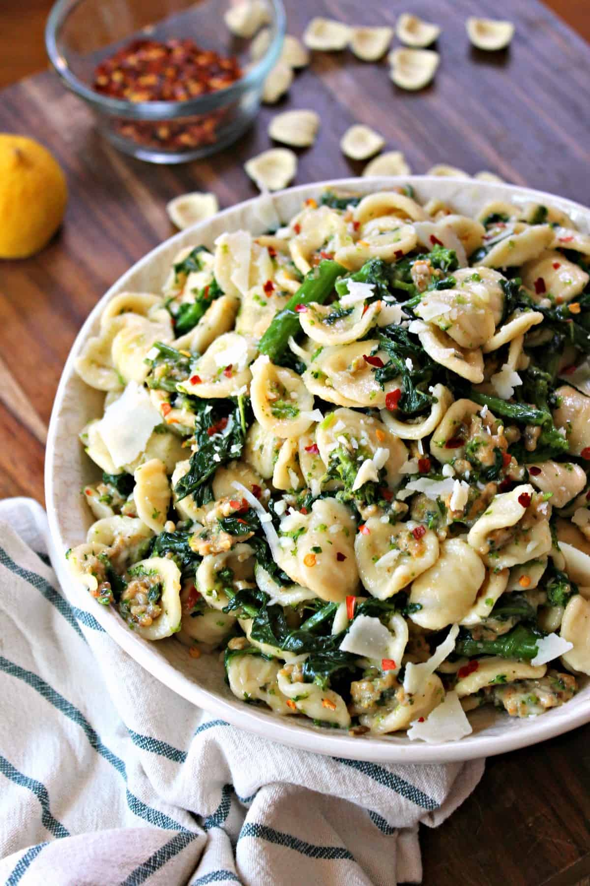 This cheesy Orecchiette Pasta has hearty sausage, sauteed broccoli rabe, and is dressed with a flavorful dressing