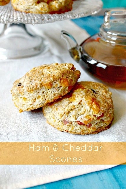 Ham & Cheddar Scones! With a flaky, buttery crust on the outside and soft, pillowy middle, these savory scones are dainty in demeanor but bold in flavor! A great way to use up leftover Easter ham or a wonderful bite to serve for showers or Mother's Day.