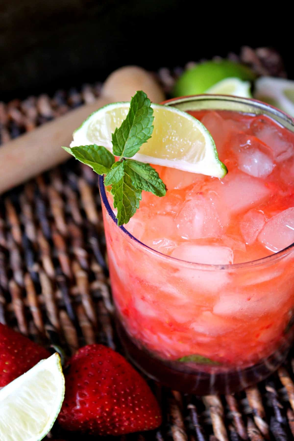 Strawberry Mojitos! Sweet and refreshing, these cocktails are a great addition to summer menus! The flavors of fresh strawberries, lime and mint come together to create a berry-infused version of a delicious classic.