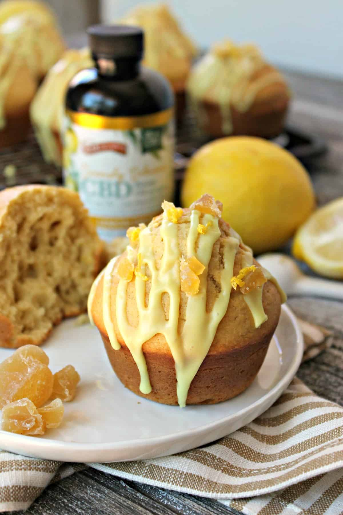 Glazed Lemon-Ginger Muffins! A perfect way to begin the day, these bright and cheerful lemon muffins are amplified by the addition of fragrant ground ginger. A sweet glaze drizzled over top and a sprinkling of candied ginger gives them a delicious finishing touch!