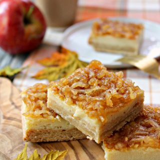 Apple Custard Bars! The autumnal answer to lemon bars, these Apple Custard bars consist of sweet and creamy apple cider-infused custard atop a brown sugar shortcrust, then smothered in a spiced apple topping.