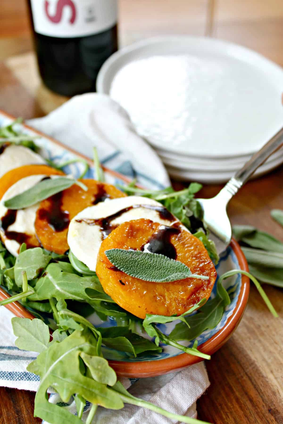 Butternut Squash Caprese Salad! A simple appetizer for autumn gatherings, roasted butternut squash salad is a fall version of the summer favorite, Caprese Salad, with tender butternut squash slices nestled between pieces of fresh mozzarella cheese and topped with earthy sage & drizzled with balsamic glaze.