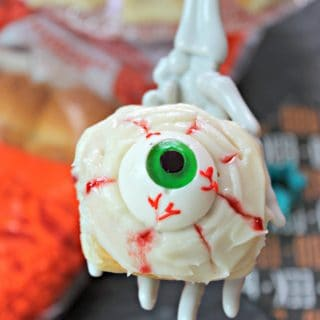 Spooky Eyeball Sweet Rolls! Need something quick and easy to make for Halloween festivities? These ooey, gooey, no-bake sweet rolls come together quickly with the help of King's Hawaiian Dinner Rolls! Filled with raspberry jam and topped with a creamy glaze and gummy eyeballs, they'll become your family's favorite creepy treat!