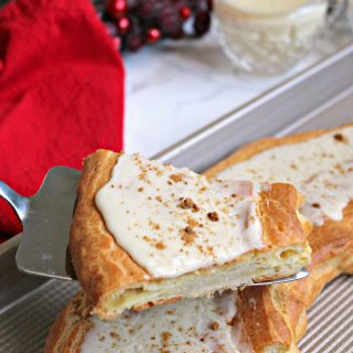 Eggnog Danish Kringle! The flavors of a favorite winter beverage shine though in this tender, glaze-covered treat that can be served for breakfast or dessert. This less labor-intensive version of the mouthwatering Danish pastry will become a holiday treat to treasure!