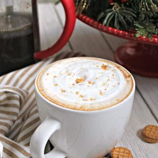 Fluffernutter Latte! This sweet, creamy homemade latte is perfect for enjoying when the temperatures drop. Made with a simple peanut butter syrup and topped off with a swirl of marshmallow fluff, you'll find yourself skipping the coffee shops and making this unique beverage at home.