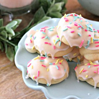 Close up of Italian Easter Cookies on a light blue platter.