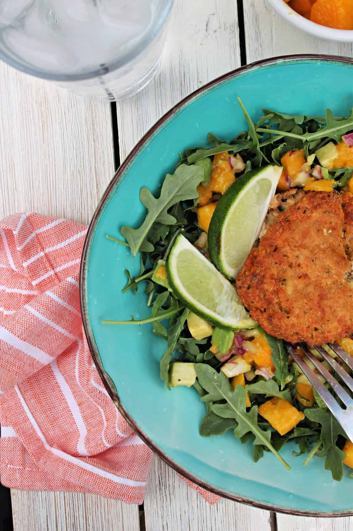 Overhead shot of Crab cake Salad on a picnic table with a napkin.